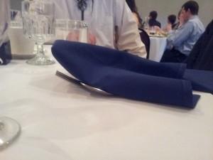 silverware hidden underneath a folded napkin
