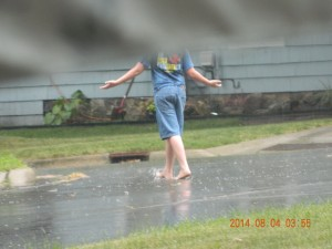 My neighbor caught this shot of my son in the rain.